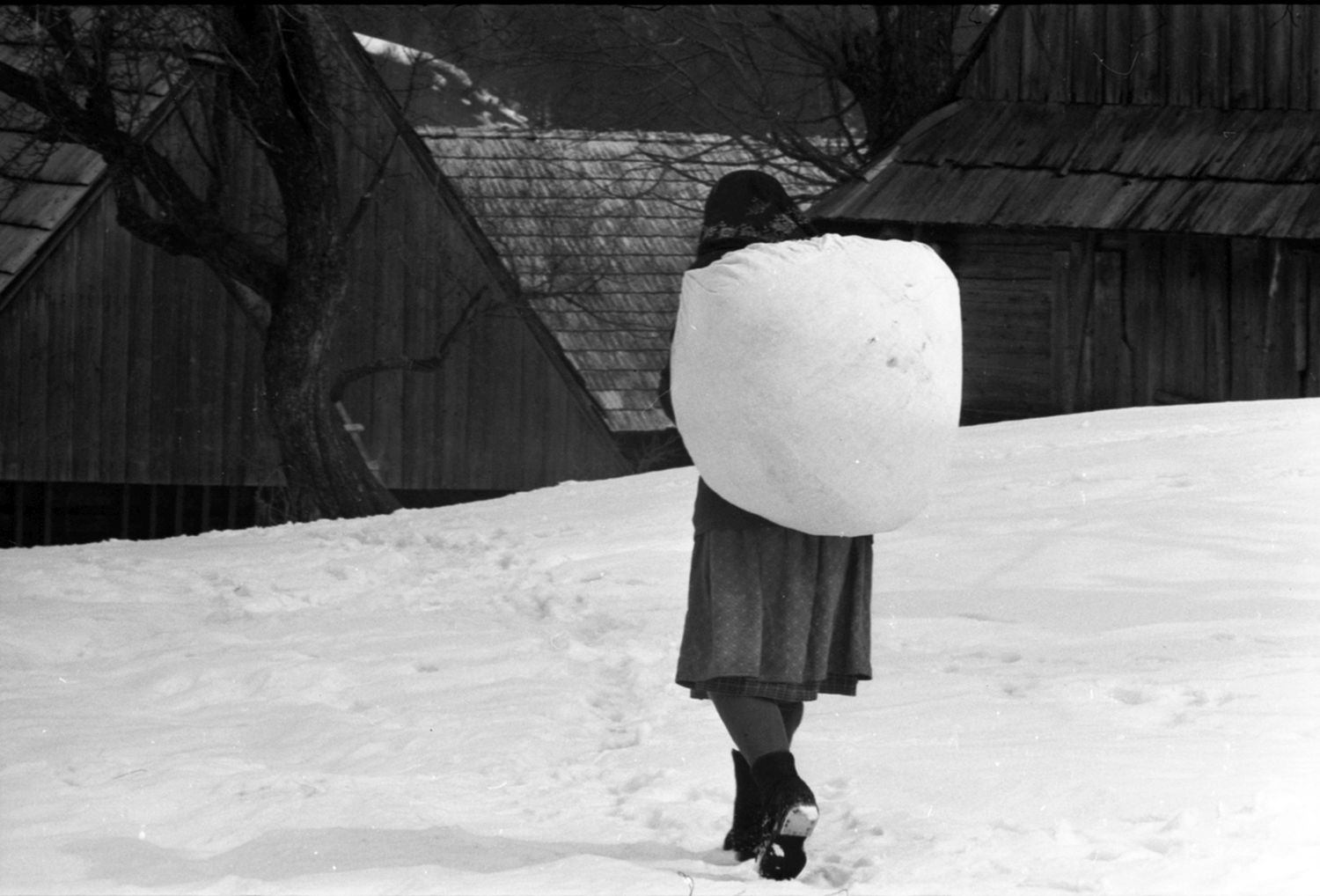 Péter Korniss: Woman Carrying Burden in the Snow