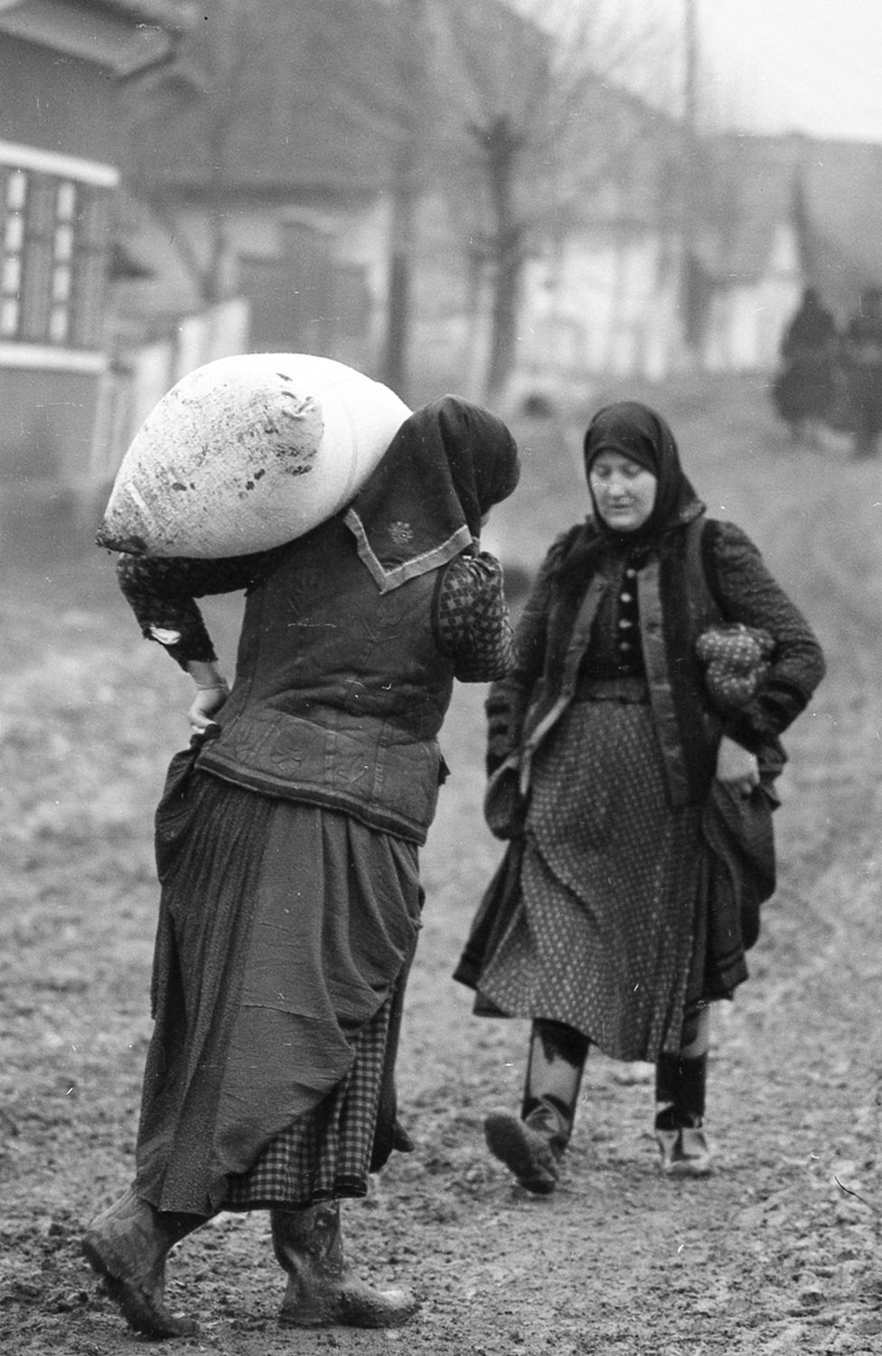 Péter Korniss: Woman Carrying Sack